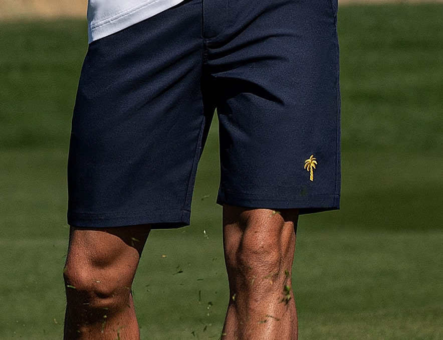 Rickie wearing Palm Tree Crew shorts on course